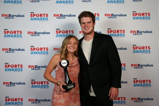 Delia Russo of Colts Neck High School, Girls Cross Country Runner of the Year, poses with New York Jets quarterback Sam Darnold during the Asbury Park Press Sports Awards at Count Basie Center for Arts in Red Bank, NJ Wednesday June 12, 2019.