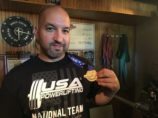 Mike Ciupinski holding his gold medal from last month's IPF World Bench Press Championships in Tokyo.