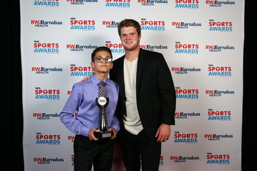 Nicholas Diaz of St. John Vianney High School, winner of the Courage Award, poses with New York Jets quarterback Sam Darnold during the Asbury Park Press Sports Awards at Count Basie Center for Arts in Red Bank, NJ Wednesday June 12, 2019.