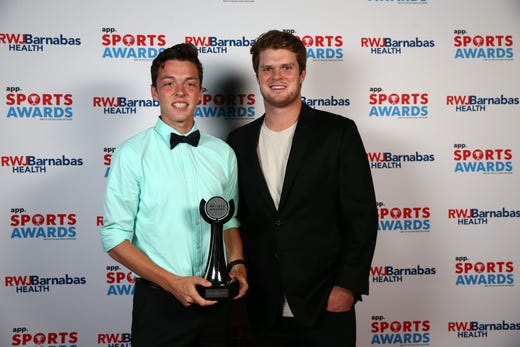 Devin Hart of Point Pleasant Boro High School, Boys Cross Country Runner of the Year, poses with New York Jets quarterback Sam Darnold during the Asbury Park Press Sports Awards at Count Basie Center for Arts in Red Bank, NJ Wednesday June 12, 2019.