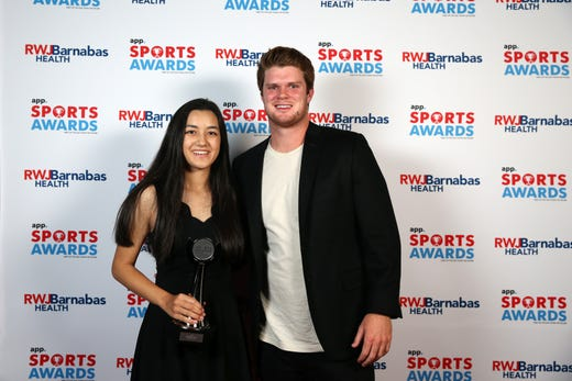 Sophia Taverna of Holmdel High School, Girls Golfer of the Year, poses with New York Jets quarterback Sam Darnold during the Asbury Park Press Sports Awards at Count Basie Center for Arts in Red Bank, NJ Wednesday June 12, 2019.