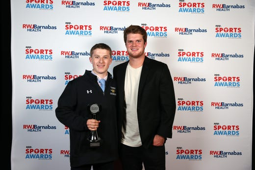 John Gutt of St. John Vianney High School, Ice Hockey Player of the Year, poses with New York Jets quarterback Sam Darnold during the Asbury Park Press Sports Awards at Count Basie Center for Arts in Red Bank, NJ Wednesday June 12, 2019.
