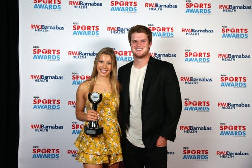 Victoria Ireland of Middletown South High School, Girls Swimmer of the Year, poses with New York Jets quarterback Sam Darnold during the Asbury Park Press Sports Awards at Count Basie Center for Arts in Red Bank, NJ Wednesday June 12, 2019.