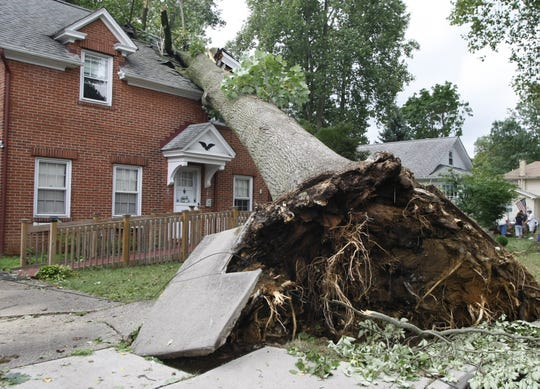2012 The July 29 storm uprooted an oak tree that fell  on a Fulton Street house in Freehold.