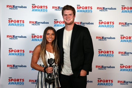 Ariana Agrapides of St. John Vianney High School, Play of the Year award winner, poses with New York Jets quarterback Sam Darnold during the Asbury Park Press Sports Awards at Count Basie Center for Arts in Red Bank, NJ Wednesday June 12, 2019.