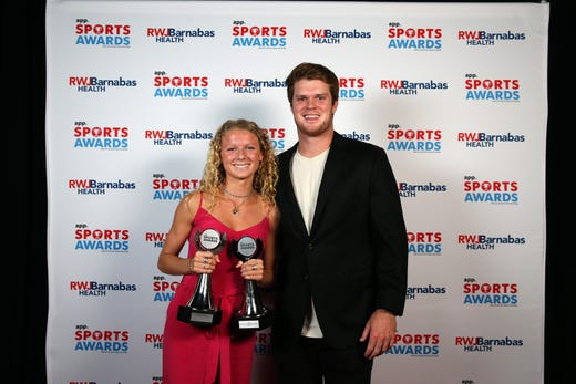Lily Orr of Rumson-Fair Haven High School, Girls Track & Field Athlete of the Year, poses with New York Jets quarterback Sam Darnold during the Asbury Park Press Sports Awards at Count Basie Center for Arts in Red Bank, NJ Wednesday June 12, 2019.