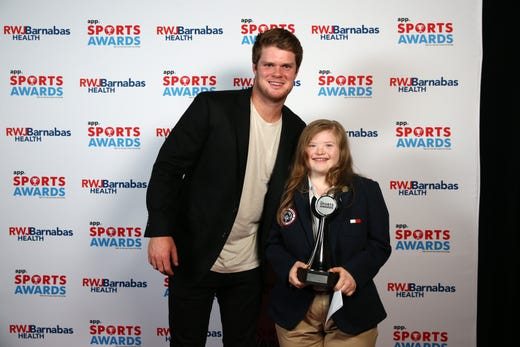 Morgan Hulteen, winner of the Girls Special Olympics Athlete of the Year Award, poses with New York Jets quarterback Sam Darnold during the Asbury Park Press Sports Awards at Count Basie Center for Arts in Red Bank, NJ Wednesday June 12, 2019.