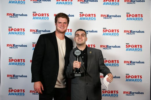 Justin Malfitano, winner of the Boys Special Olympics Athlete of the Year Award, poses with New York Jets quarterback Sam Darnold during the Asbury Park Press Sports Awards at Count Basie Center for Arts in Red Bank, NJ Wednesday June 12, 2019.