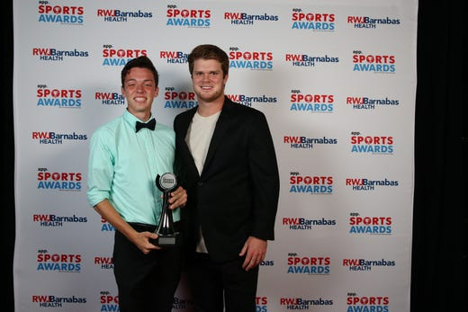 Devin Hart of Point Pleasant Boro High School, Boys Track & Field Athlete of the Year, poses with New York Jets quarterback Sam Darnold during the Asbury Park Press Sports Awards at Count Basie Center for Arts in Red Bank, NJ Wednesday June 12, 2019.