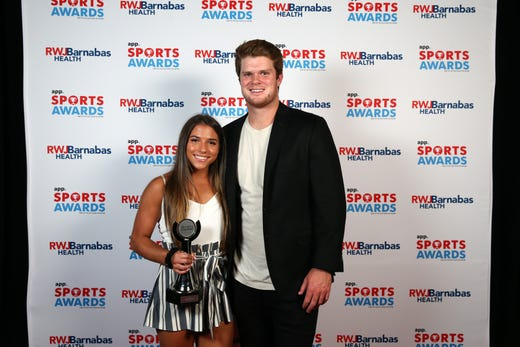 Ariana Agrapides of St. John Vianney High School, Girls Athlete of the Year, poses with New York Jets quarterback Sam Darnold during the Asbury Park Press Sports Awards at Count Basie Center for Arts in Red Bank, NJ Wednesday June 12, 2019.
