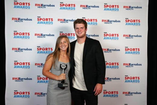 Lily Santi of Shore Regional High School, Field Hockey Player of the Year, poses with New York Jets quarterback Sam Darnold during the Asbury Park Press Sports Awards at Count Basie Center for Arts in Red Bank, NJ Wednesday June 12, 2019.