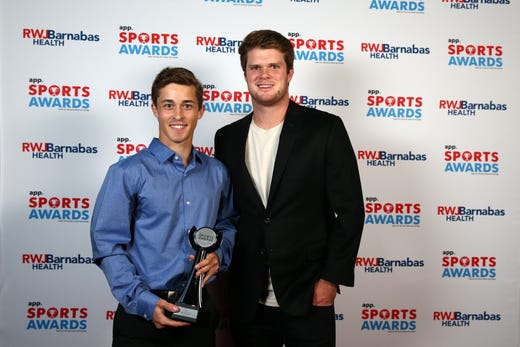 Eitan Khromchenko of Marlboro High School, Boys Tennis Player of the Year, poses with New York Jets quarterback Sam Darnold during the Asbury Park Press Sports Awards at Count Basie Center for Arts in Red Bank, NJ Wednesday June 12, 2019.