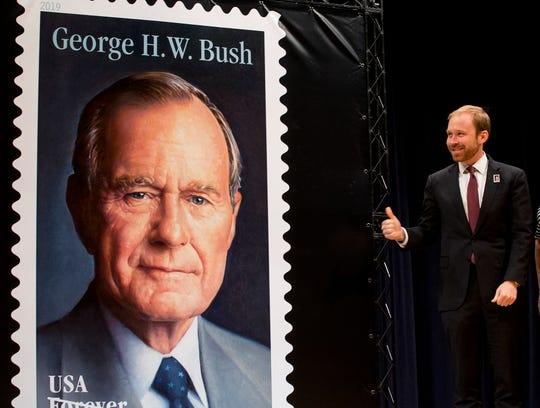 "Pierce Bush, grandson of former President George H.W. Bush, gives a thumbs-up after the unveiling the ""forever"" stamp honoring the 41st president of the United States on Wednesday in College Station, Texas."
