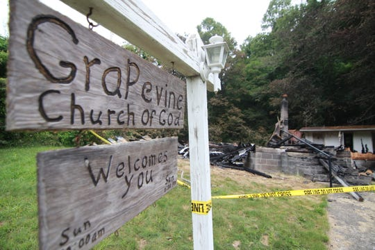 Only the church sign and a separate building for bathrooms remained of the Grapevine Church of God after a fire in the early morning hours of June 10.