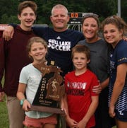 Gull Lake girls soccer coach Jeff Corstange, a three-time state championship coach, has decided to step down from the program. Here he celebrates a recent regional championship with his family.