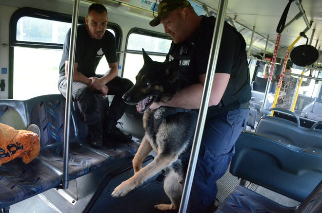 Battle Creek police officer Jim Bailey trains with Rushin in May at the Calhoun County fairgrounds in Marshall.