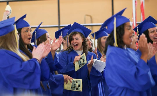 Incarcerated women at the Mission Creek Correctional Center for Women cheer during a graduation ceremony at the prison on Wednesday.