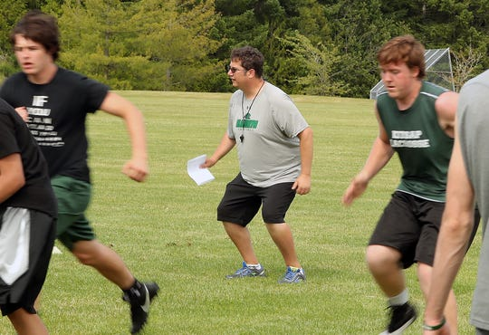 Klahowya head coach Jeff Witte tells his team to watch their form as they move through drills during practice after school on Tuesday, June 11, 2019.