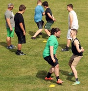 Klahowya football players move through shadow drills during practice on Tuesday, June 11, 2019.
