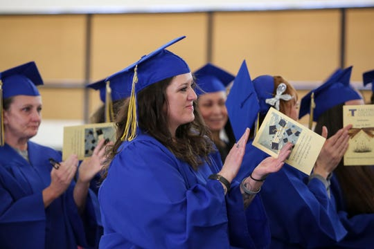 Christina Flesner received her certificate in entrepreneurship at Mission Creek Corrections Center in Belfair on Wednesday. Flesner didn't graduate from high school, but she earned her GED and the certificate while incarcerated.