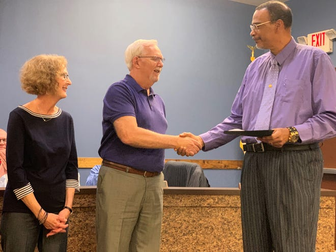 Alderman Carlos Showers, right, congratulates Black Mountain-Swannanoa Chamber of Commerce executive director Bob McMurray on his upcoming retirement as McMurray's wife Pam looks on. A reception at the Hampton Inn at 5 p.m. on June 26 will be held in honor of McMurray. The event is open to the public.
