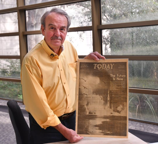 John Slack was a staff photographer at TODAY newspaper, now FLORIDA TODAY, from 1966 to 1970. Here he holds the front page of TODAY newspaper from July 17, 1969, the day after the launch of Apollo 11.
