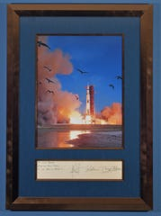 John Slack was a staff photographer at TODAY newspaper, now FLORIDA TODAY, from 1966 to 1970. He captured the photo of the Apollo 11 launch that ran full page in black and white on the front page of TODAY newspaper on July 17, 1969. His wife had the picture blown up in color and signed by the three Apollo 11 astronauts, as seen in this photo.