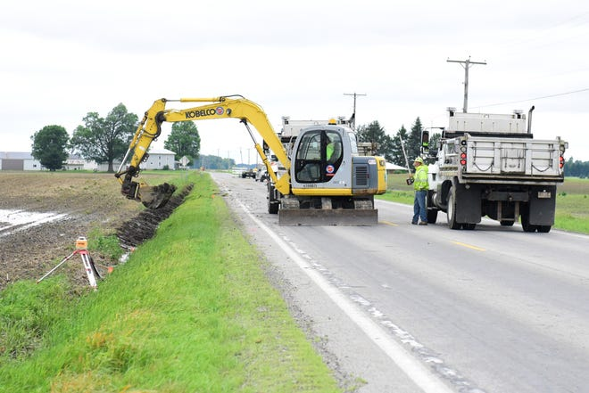Workers from the Ohio Department of Transportation clean out ditches along Ohio 19 between Galion and Bucyrus. The road is scheduled to open again Friday afternoon after a week of being closed for culvert replacement.