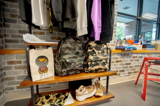 A selection of BAPE products for sale at Underground Closet in Burlington, VT. BAPE is one of the many streetwear brands selling merchandise at high prices.