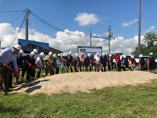 City officials and members involved with the Salvation Army's Center of Hope project kick off construction during a Thursday ground breaking ceremony.