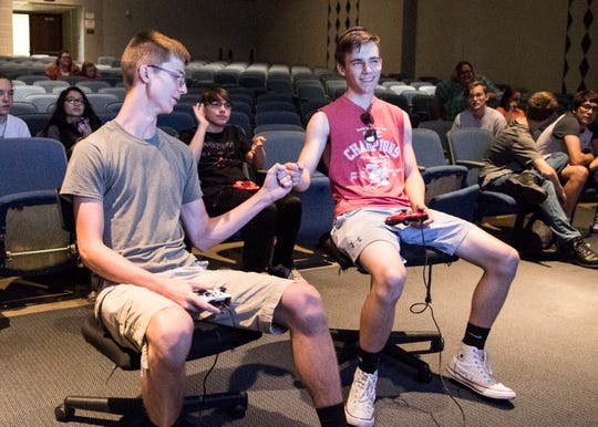 (L-R) Treble Hook and Nate Roy congratulate one another after a game of Super Smash Bros at Chillicothe Middle School on June 11, 2019.