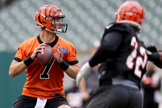 Cincinnati Bengals quarterback Jake Dolegala (7) drops back to throw during Cincinnati Bengals minicamp practice, Thursday, June 13, 2019, at Paul Brown Stadium in Cincinnati.