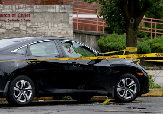 Cincinnati Police investigate a shooting in the parking lot of Hook Fish & Chicken in Bond Hill on June 13, 2019.