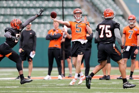 Cincinnati Bengals quarterback Ryan Finley (5) throws during Cincinnati Bengals minicamp practice, Thursday, June 13, 2019, at Paul Brown Stadium in Cincinnati.