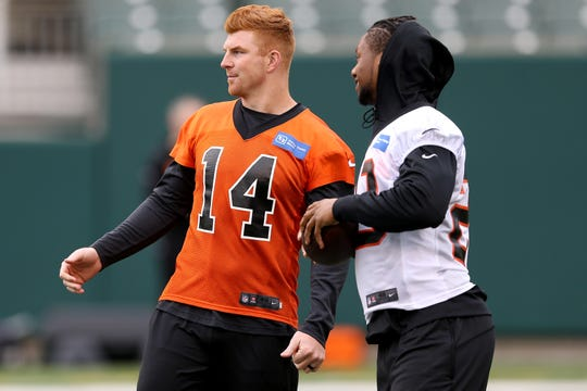 Cincinnati Bengals quarterback Andy Dalton (14) and Cincinnati Bengals running back Joe Mixon (28) talk during Cincinnati Bengals minicamp practice, Thursday, June 13, 2019, at Paul Brown Stadium in Cincinnati.