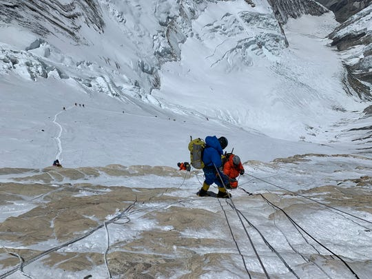 Climbers, including University of Cincinnati graduate Matt Brennan, climbing Mount Everest.