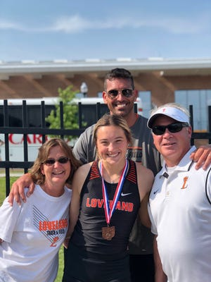 Loveland's Miya Brines (LHS '21), here with her parents and Coach Herbert Laughman, placed fourth in the 100-meter hurdles at the 2019 OHSAA Track and Field State Championship in Columbus on June 1.