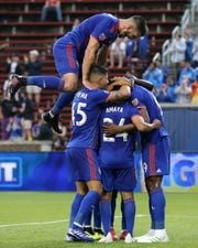 FC Cincinnati forward Fanendo Adi (9) is congratulated after scoring a goal in the first half of a US Open Cup match against the Louisville City FC, Wednesday, June 12, 2019, at Nippert Stadium in Cincinnati.