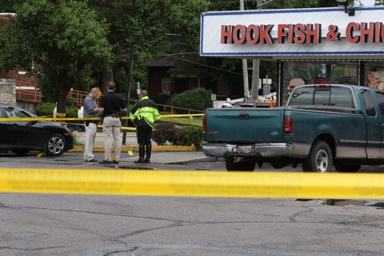Scene from shooting in the parking lot of Hook, Fish and Chicken at Reading and Dale in Bond Hill.