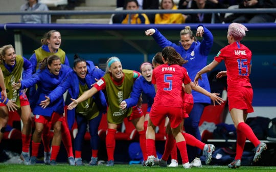 United States forward Mallory Pugh (2) celebrates a goal with Kelley O'Hara (5) and Megan Rapinoe (15) and teammates on the bench during the second half in group stage play during the FIFA Women's World Cup France 2019 at Stade Auguste-Delaune.