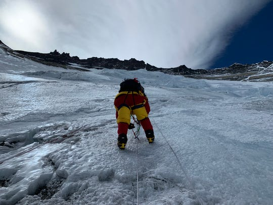 UC graduate Matt Brennan on the steep slopes of Mount Everest.