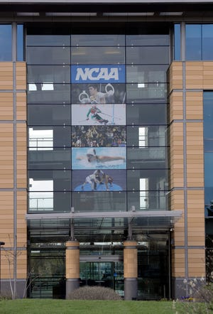 The NCAA headquarters is pictured, Wednesday, April 25, 2018, in Indianapolis. The Commission on College Basketball led by Former U.S. Secretary of State Condoleezza Rice, released a detailed 60-page report Wednesday, seven months after the NCAA formed the group to respond to a federal corruption investigation that rocked college basketball.