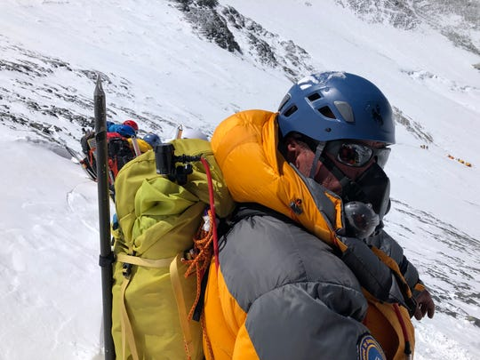 Miami Township resident and adventurer Matt Brennan wearing an oxygen mask on Mount Everest.