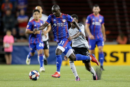 FC Cincinnati forward Kekuta Manneh (31) dribbles upfield in the second half of a US Open Cup match, Wednesday, June 12, 2019, at Nippert Stadium in Cincinnati. Cincinnati won 2-1.