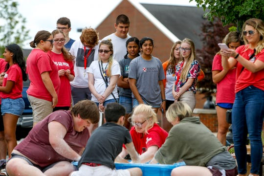 Visiting high school students watch as APSU students mix together a concoction during Gov Camp where as a part of their physics program students learned about a water and corn starch mixture that hardened up when hit at Castle Heights hall on Austin Peay in Clarksville, Tenn., on Wednesday, June 12, 2019.