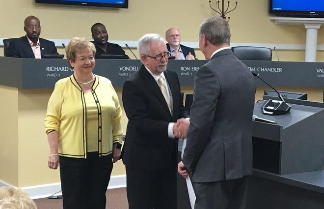 Gary Norris is welcomed to the Clarksville City Council by Mayor Joe Pitts after being sworn in at the meeting on Thursday, June 13, 2019.