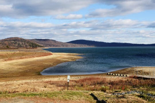 The reservoir in Round Valley State Park attracts swimmers, boaters, fishermen, picnickers and campers to its scenic shore
