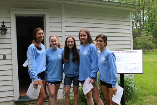 Julianna Pontoriero, Fiona Shanahan, Jessica Madura, Charlotte Holliday, and Emma Grochowski outside of Kirch Ford House just prior to starting a tour.