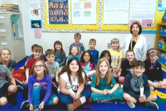 Judith Buffa's second grade class. Front row, second from left, Raegan Haluszka and top row-far right, Dr. Barbara Ronca