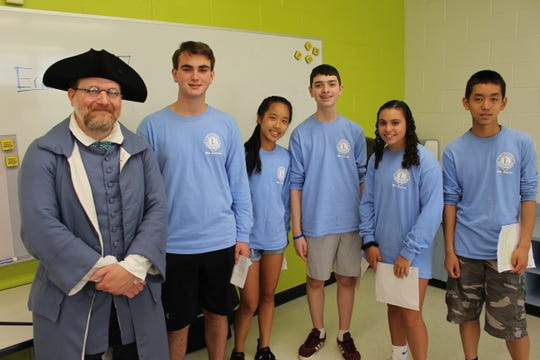 (Gen. Washington's Middlebrook Encampment Site 1777). From left to right the students are John Williams, Vanessa Tao, Dominic Popolo, Ava Bateh, Daniel Shen and guest presenter Doug Aumack portraying a colonial physician.